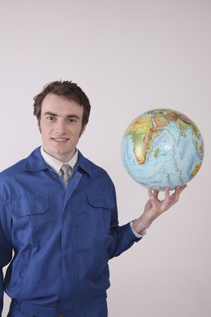 Man holding globe smiling Stock Photo - 6990836