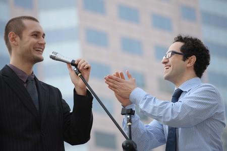 Businessman giving speech, man clapping hands photo