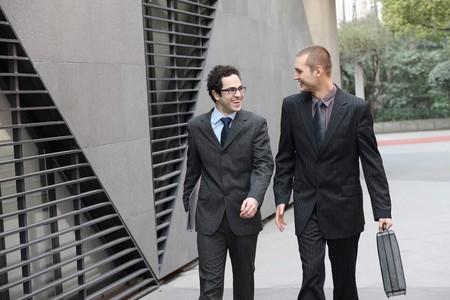 Businessmen chatting while walking photo