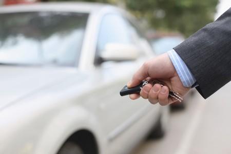 Businessman unlocking car Stock Photo - 6866676