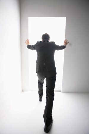 Businessman blocking himself from entering the bright pathway Stock Photo - 6866678
