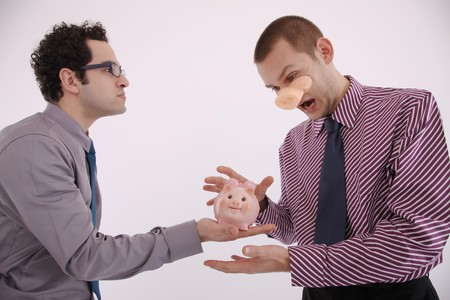 mouth opened: Businessman holding piggy bank, man with pigs snout looking at it with his mouth opened