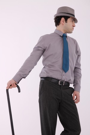 Businessman with cane and fedora photo