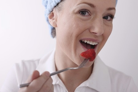 Woman eating strawberry Stock Photo - 6990864