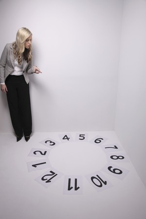 Businesswoman counting the numbers on the floor photo