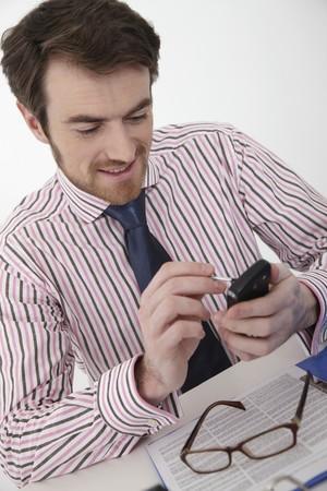 Man text messaging photo