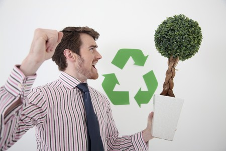 Man holding potted plant while shouting Stock Photo - 6990903
