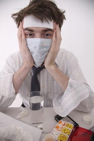 north western european descent: Sick man wearing surgical mask