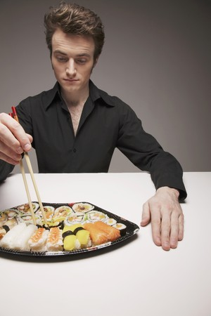 Man having sushi meal photo