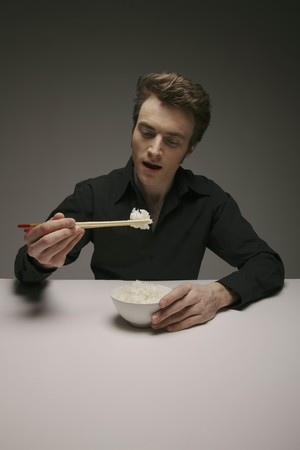 Man eating white rice with chopsticks Stock Photo - 6990926