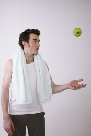 Man throwing green apple up in the air Stock Photo - 6990929