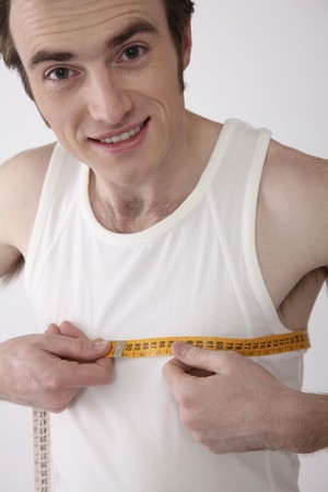 Man measuring his chest Stock Photo - 6990930