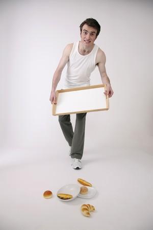 Man dropped tray with breakfast Stock Photo - 6990935
