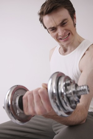Man lifting weights Stock Photo - 6990937
