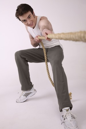Man pulling rope photo