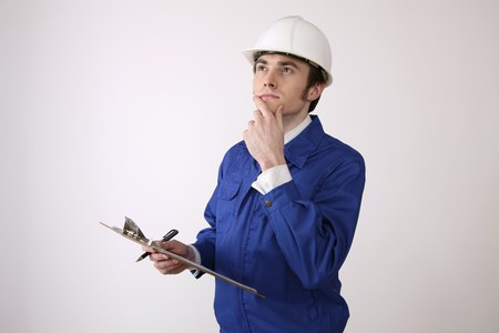 Man holding clipboard contemplating Stock Photo - 6990939