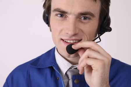 Man with telephone headset photo
