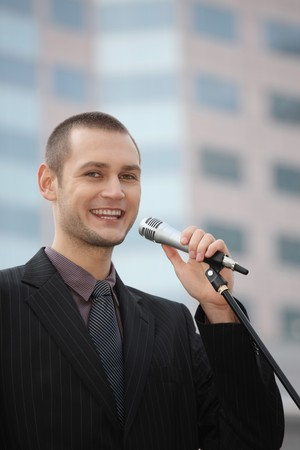Businessman giving speech photo
