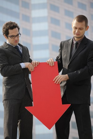 Businessmen with arrow sign pointing down photo