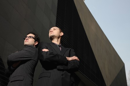 folding arms: Businessmen folding arms while looking away