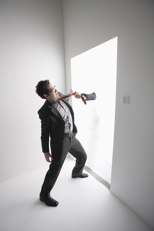 Hand pulling businessman's necktie Stock Photo - 6990958