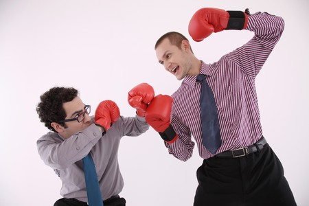 Businessmen with boxing gloves fighting photo