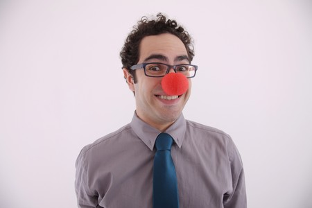 Businessman wearing clowns nose photo