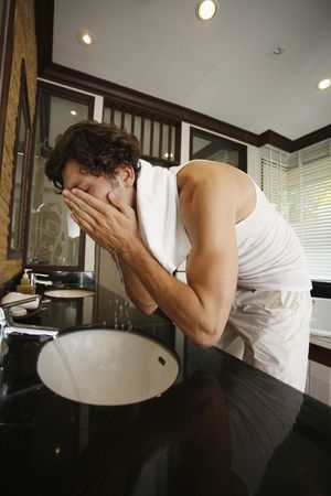 Man washing his face Stock Photo - 6925071
