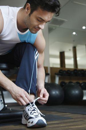 tying: Man tying his shoe laces Stock Photo