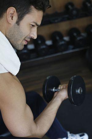 Man lifting weights Stock Photo - 6925016