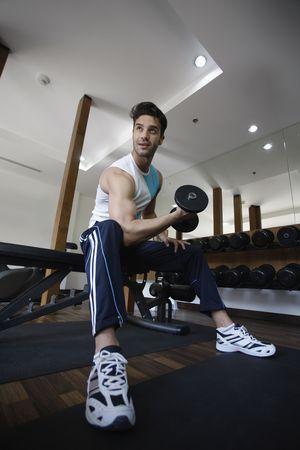 Man lifting weights Stock Photo - 6925000