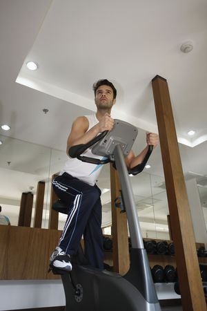 Man on exercise bike at gym Stock Photo - 6925004
