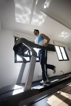 contentment: Man running on treadmill