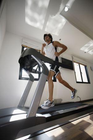 turkish ethnicity: Man running on treadmill