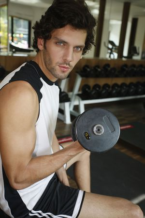turkish ethnicity: Man lifting weights Stock Photo