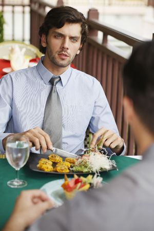 Businessmen having lunch at a restaurant Stock Photo - 6925035