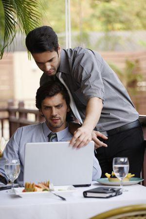 Businessmen discussing work over lunch at restaurant Stock Photo - 6925032