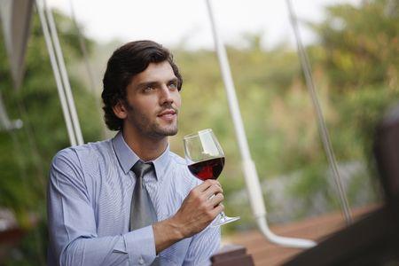 Businessman enjoying a glass of wine photo