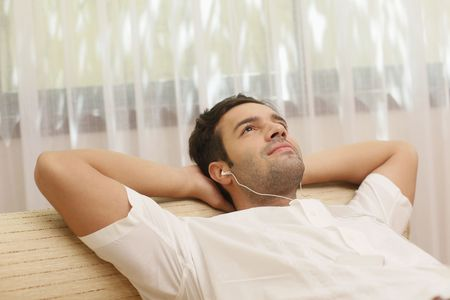 Man listening to music on portable mp3 player Stock Photo - 6925053