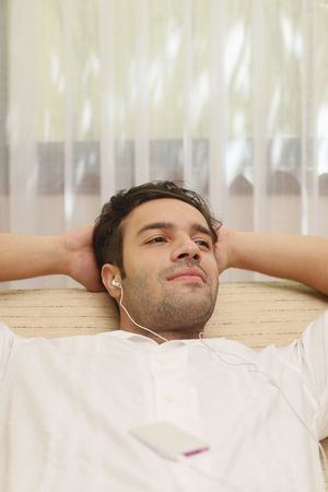 Man listening to music on portable mp3 player Stock Photo - 6925046
