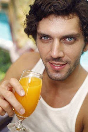 Man holding a glass of orange juice Stock Photo - 6974160