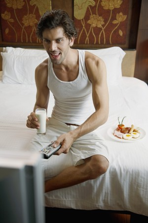 Man having breakfast while watching television Stock Photo - 6974170