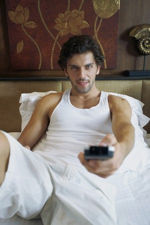 Man with remote control watching television Stock Photo - 6974174