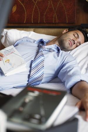 sleeping businessman: Businessman sleeping after reading