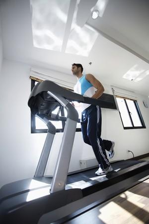 Man running on treadmill Stock Photo - 6974203