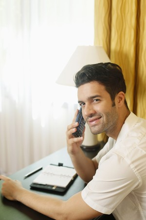 Man talking on the phone with organizer on the table Stock Photo - 6974227