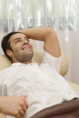 Man listening to music on portable mp3 player Stock Photo - 6974230
