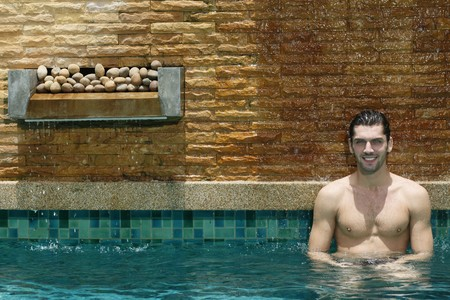 turkish ethnicity: Man relaxing in the pool