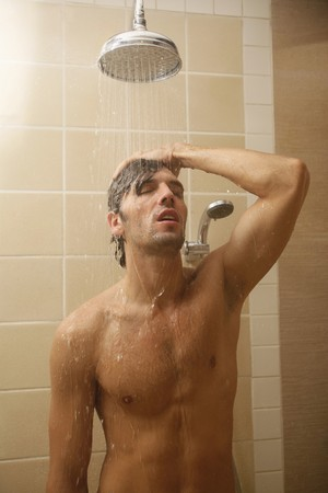 man shower: Man taking a shower