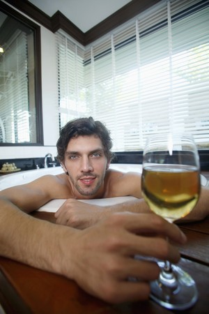 Man enjoying champagne while relaxing in bubble bath Stock Photo - 6974262